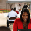 Shaterica Asberry attends a job fair at the T.R. Hoover Multipurpose Center in Dallas, TX, on Sep. 24, 2020. Though the job fair is a virtual event, T.R. Hoover's parking lot was set up to offer laptops and a Wi-Fi for area residents to use. (Jason Janik/Special Contributor)