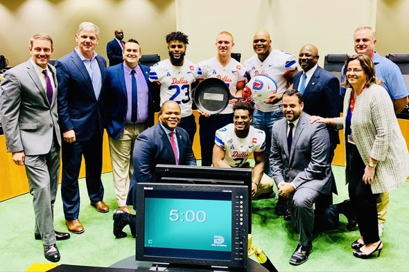 SMU football players showed off the Iron Skillet at Dallas City Hall after winning it in 2019.