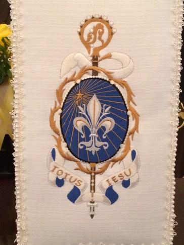 Her abbatial coat of arms.