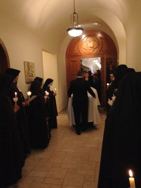 The sisters sang the Jubilee Hymn as the procession followed Mother's body to the cloister chapel.