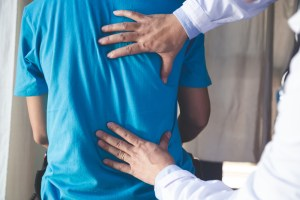 Doctor consulting a patient with Back problems