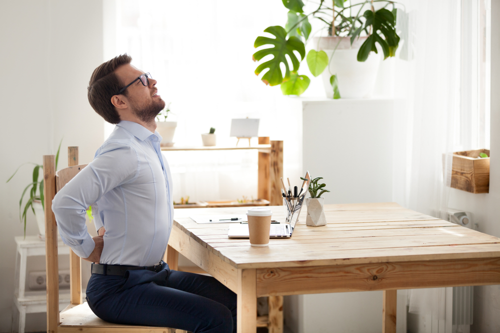 office worker stretching in chair