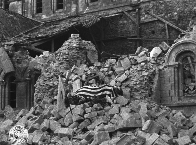 Image of: Major Howie's body was symbolically laid on the rubble of St. Croix Cathedral.