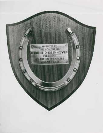 """""""Lucky"""" horseshoe sent to President Eisenhower that was displayed above his door during his stay. Upon his release, Eisenhower gifted the horseshoe back to the hospital, in the hopes the luck it brought him would confer upon other patients."""