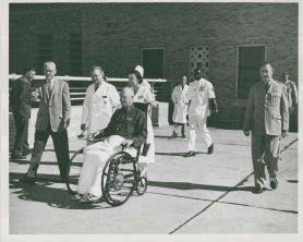 Arriving to the 8th floor sundeck for the first press photographs since the heart attack, October 25, 1955.
