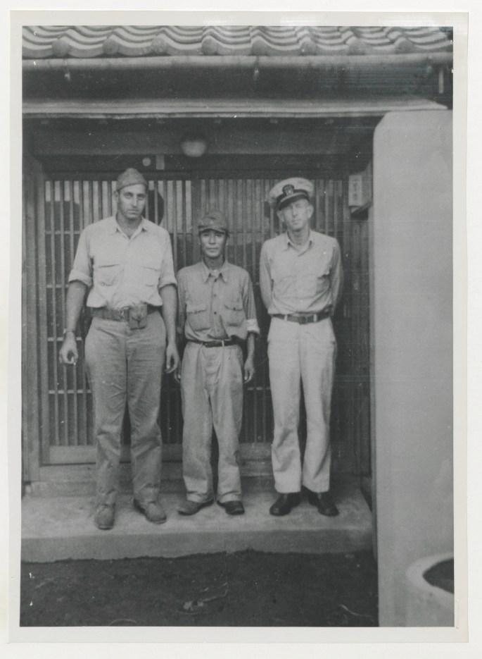 Image of Little, Yamauchi, and guard.