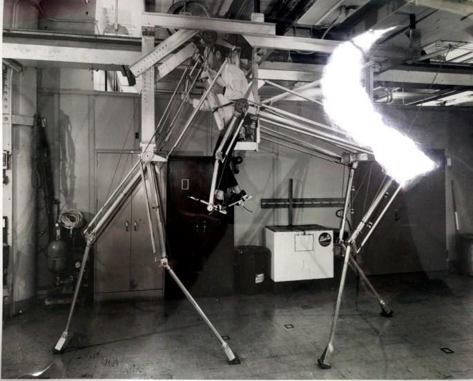 photograph of a man in a quadruped machine