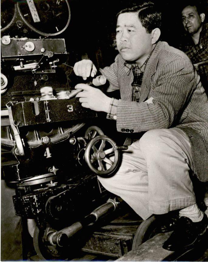 Image of James Wong Howe behind a camera