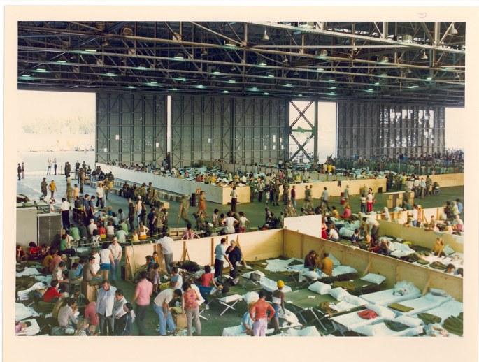 overhead view of dozens of people in hanger
