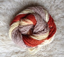 Self striping organic merino wool dyed with madder (red) and alkanet (grey). Alum mordant.