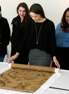 Students from Philadelphia University learning firsthand about Renaissance textiles