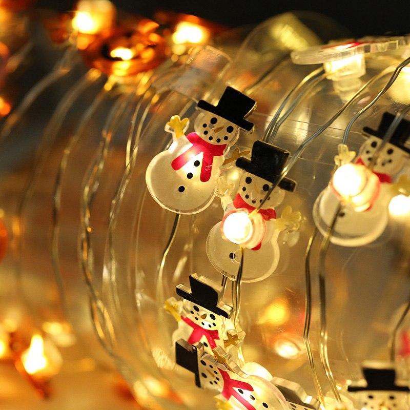 Веселенькие огоньки в форме снеговиков