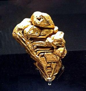 Gold in abstrakter Form