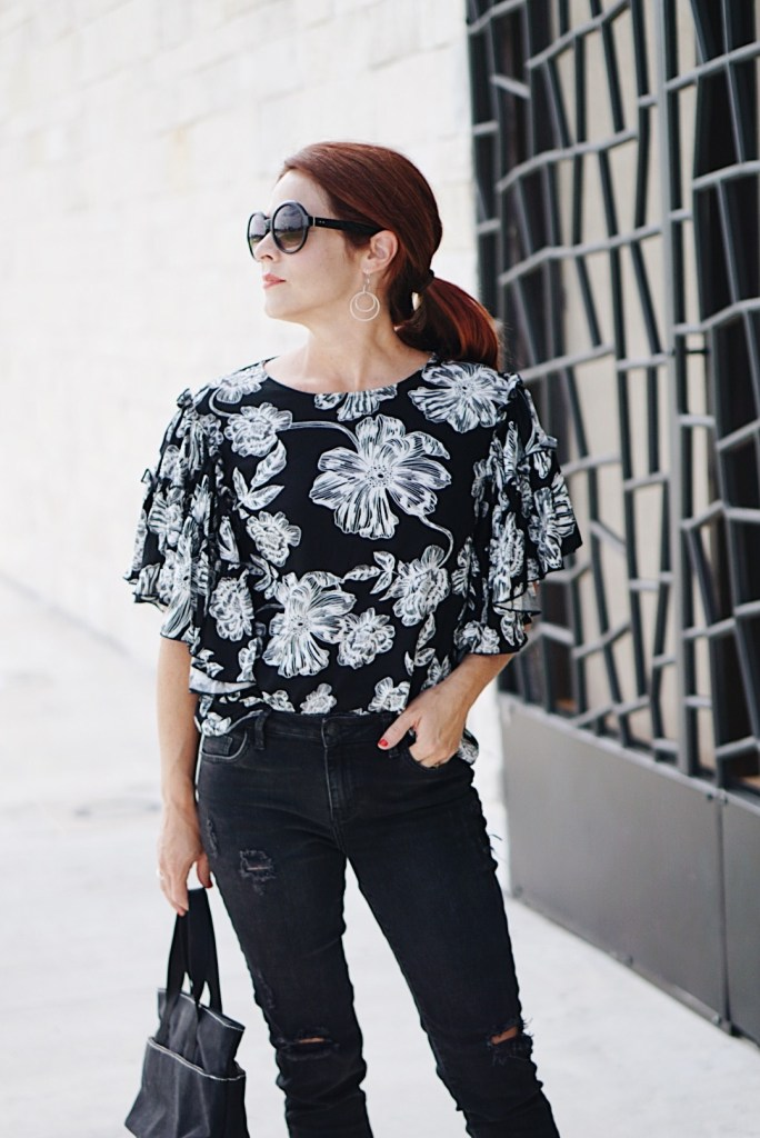 low pony tail, casual chic inspiration, distressed jeans, blag canvas, red hair inspiration, black and white floral, who what wear