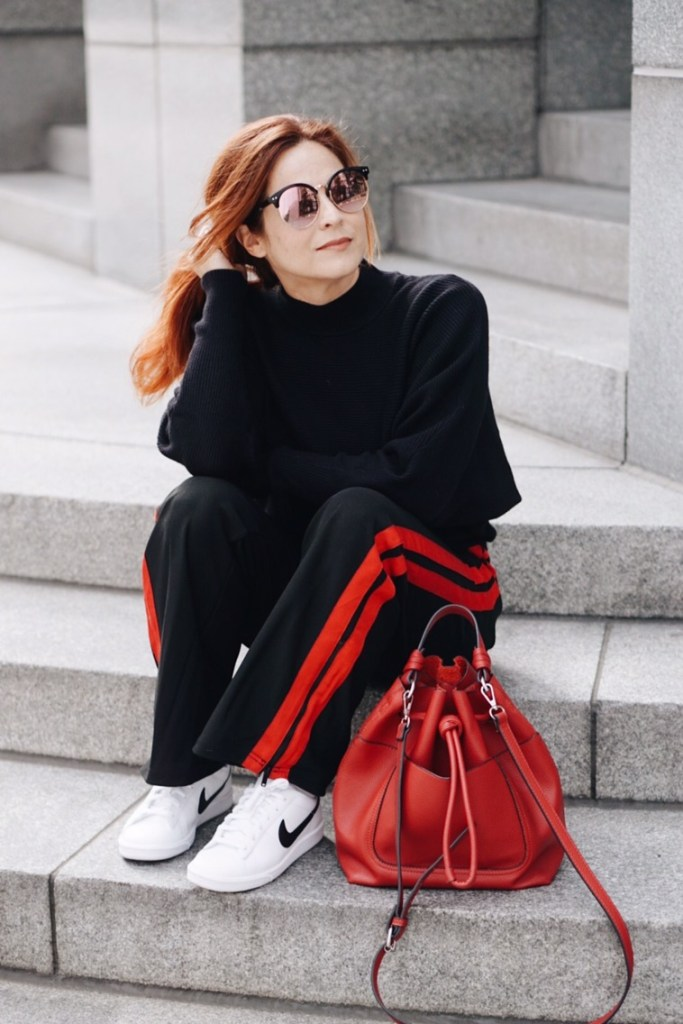 casual style, stylish athleisure looks, bucket bags, track pants with stripe, red hair