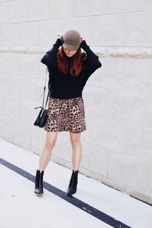 fiddler hat, jersey cap, leopard dress, black booties, nine west bag, styling with a hat, batwing sweater, black sweater, nine west bag, stuart weitzman boots