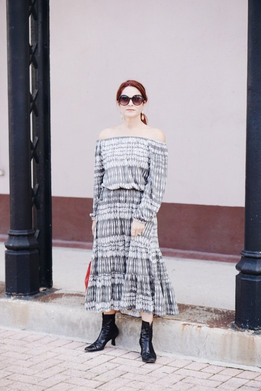 bohemian dress, rachel zoe inspired dress, black boots, round black sunglasses, grey printed dress, off the shoulder dress, off the shoulder