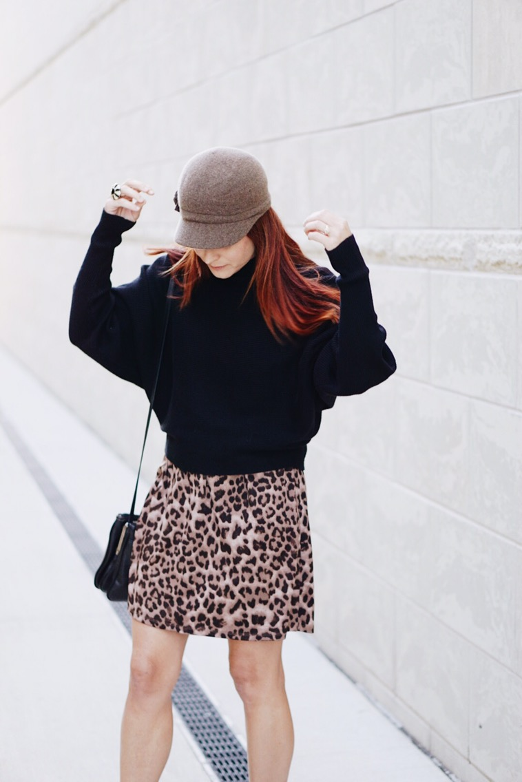 batwing sweater, black sweater, fiddler hat, leopard skirt, zara