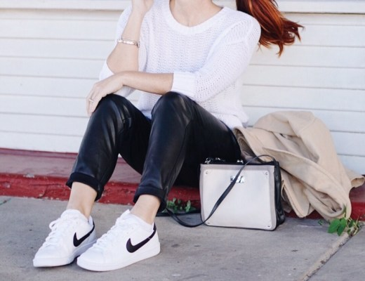 leather pants, sneakers, square bag, tan coat, white relaxed sweater