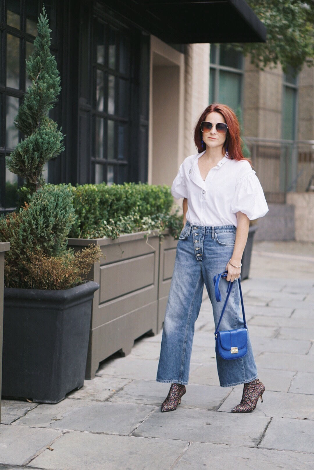 floral booties, white puff top, wide denim, quay sunglasses, blue small bags