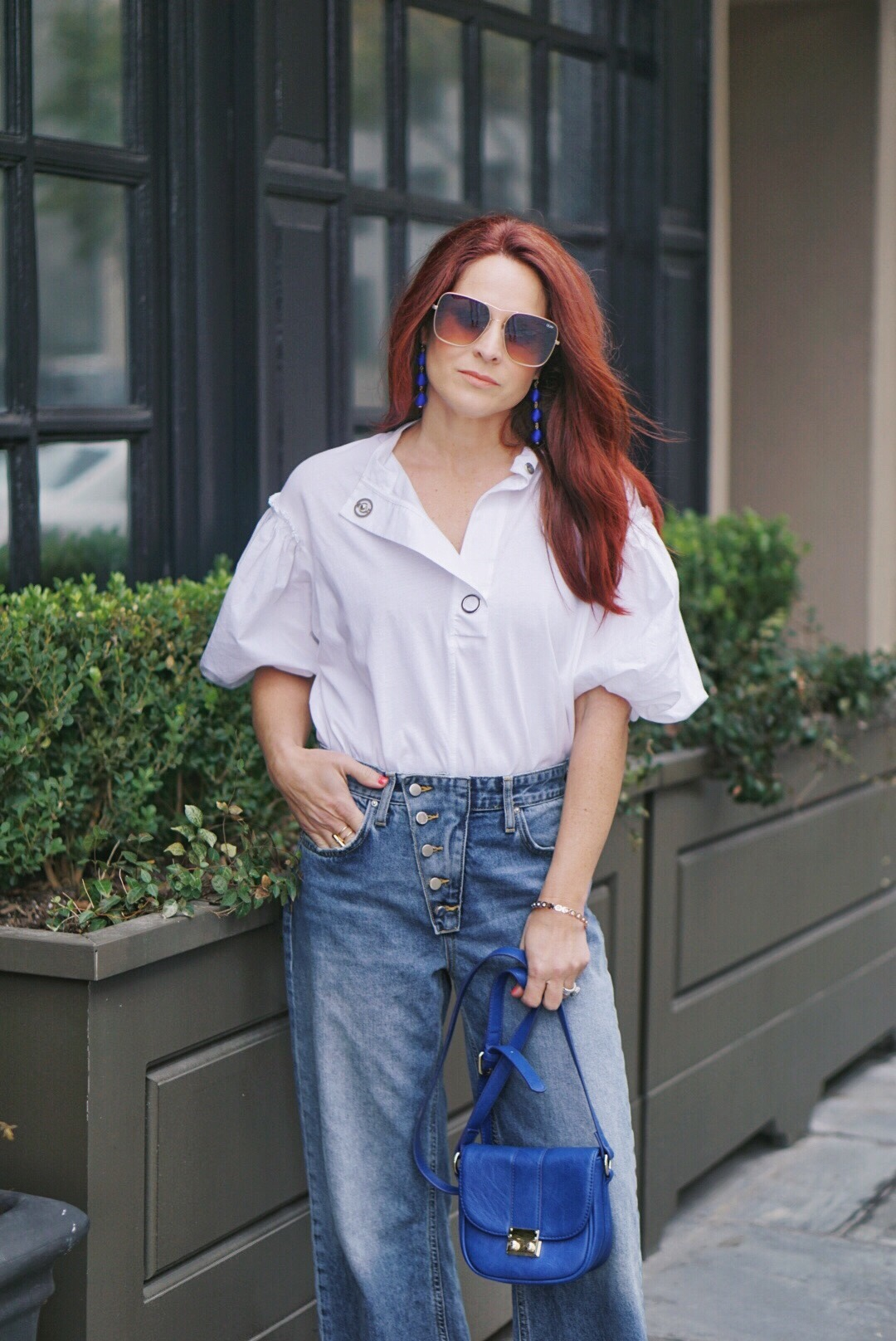 dramatic sleeves, relaxed fit jeans, red hair styles, quay sunglasses, blue bags,