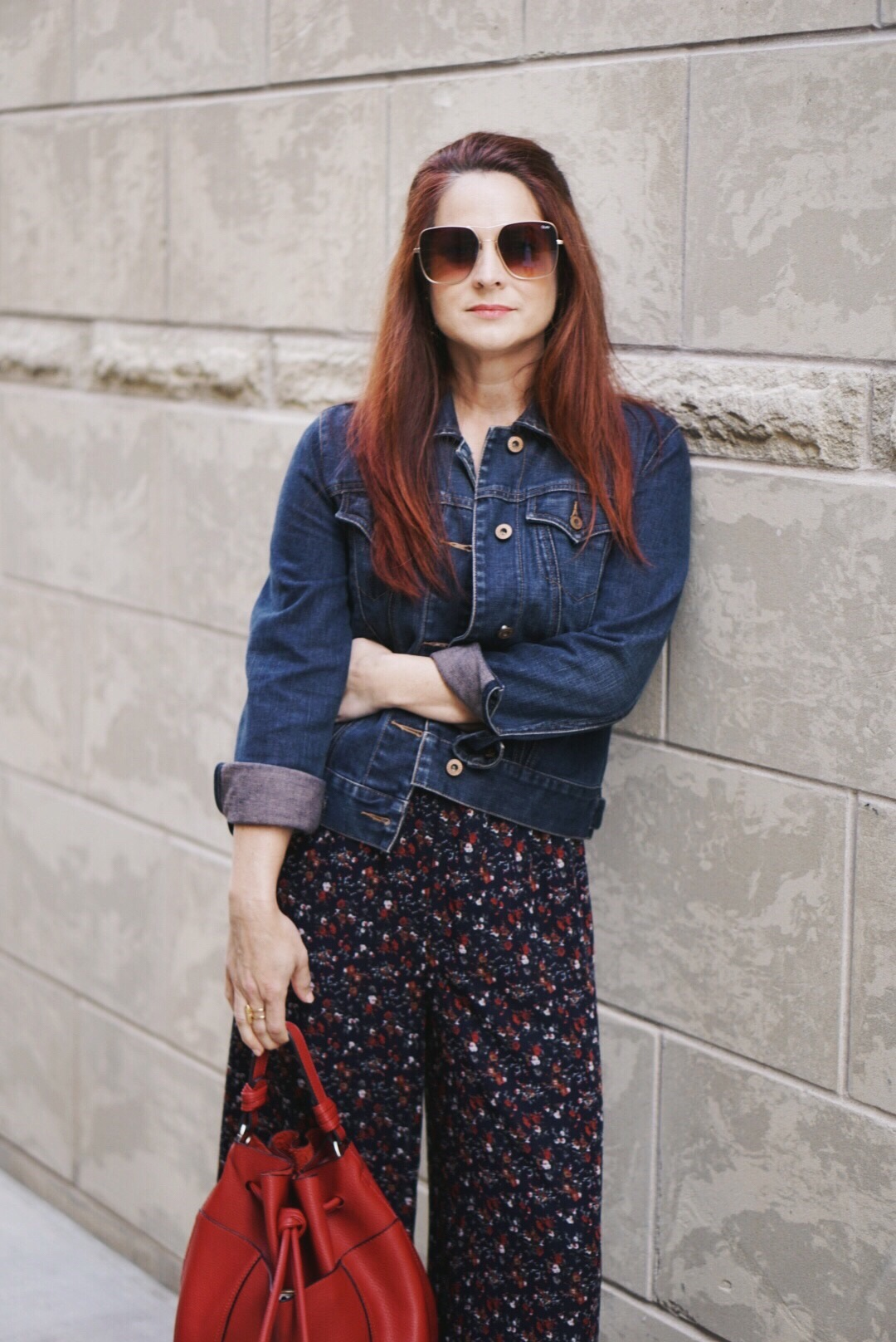 red handbag, floral pants, jean jacket, quay sunnies, rose bush pruning, cutting back tips