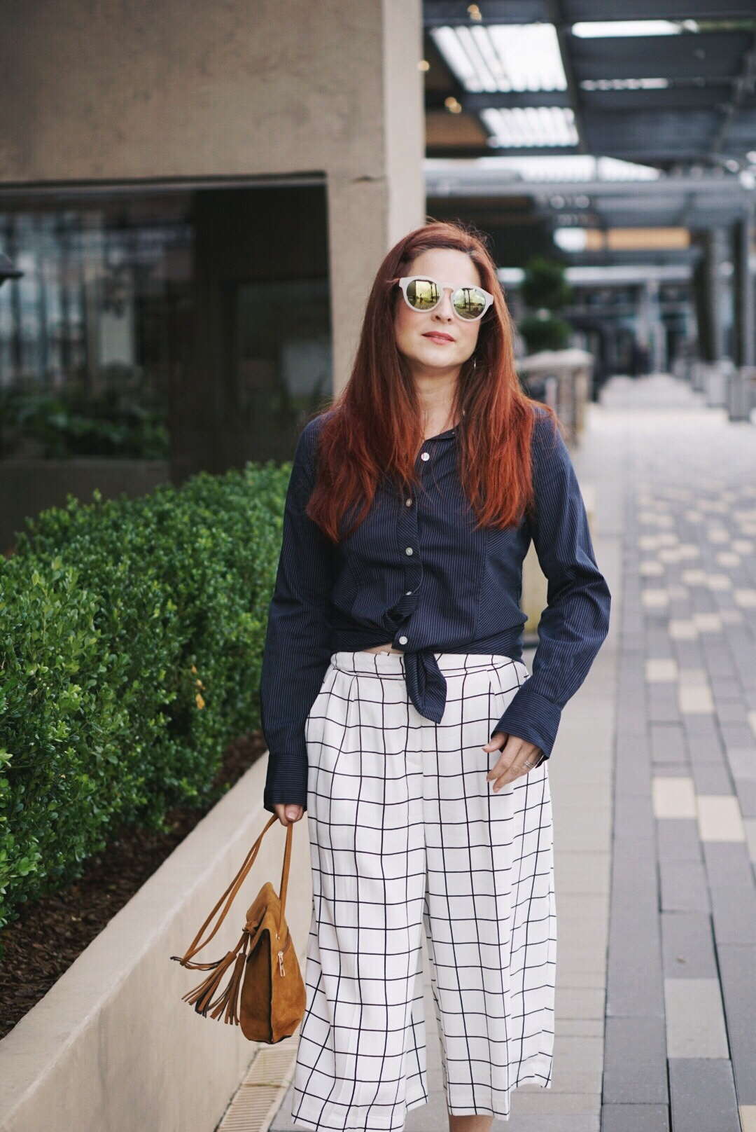 best pant for all seasons, blue button up shirt, grid culotte pants, fringe bag, sixties style sunglasses, red hair ideas, culotte outfits