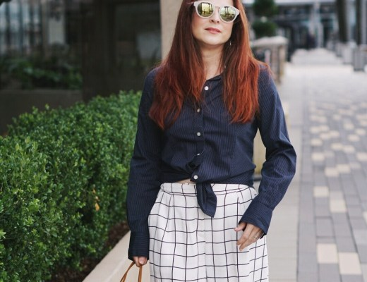 blue button up shirt, grid culotte pants, fringe bag, sixties style sunglasses, red hair ideas, culotte outfits