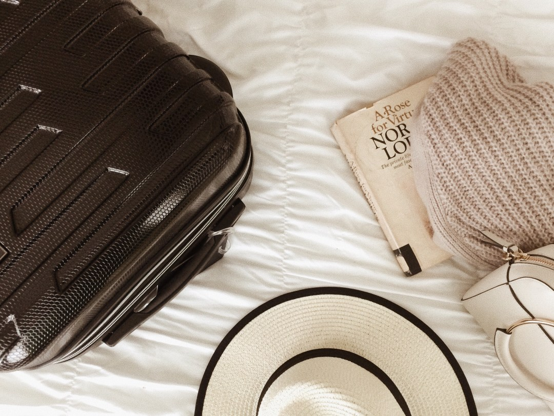 luggage, carry on only, Europe trip, straw hat, cardigan, travel diary