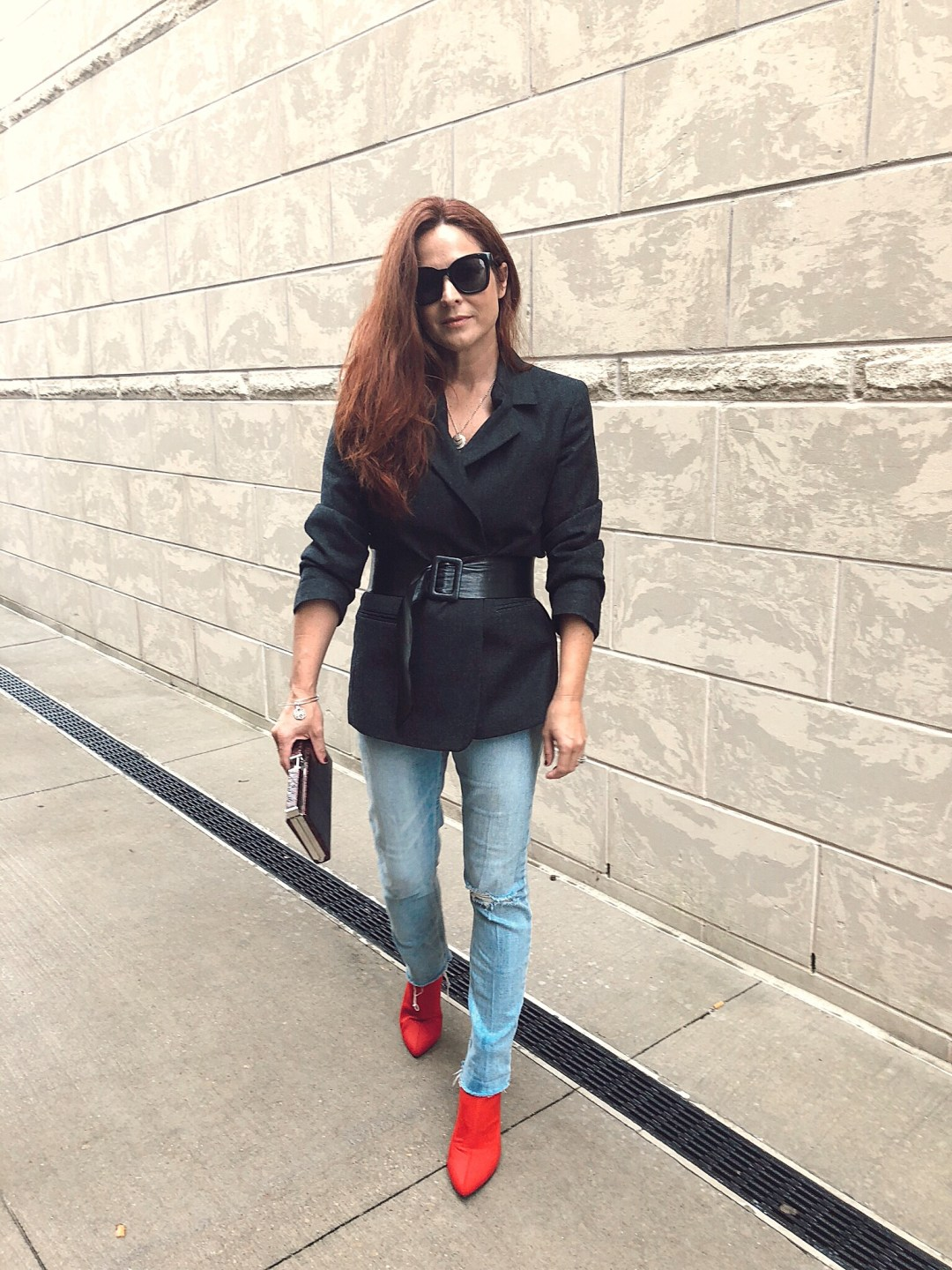 blazers with jeans ideas, red boot outfits, how to add a belt to a jacket, outerwear outfits, distressed jeans, small clutches