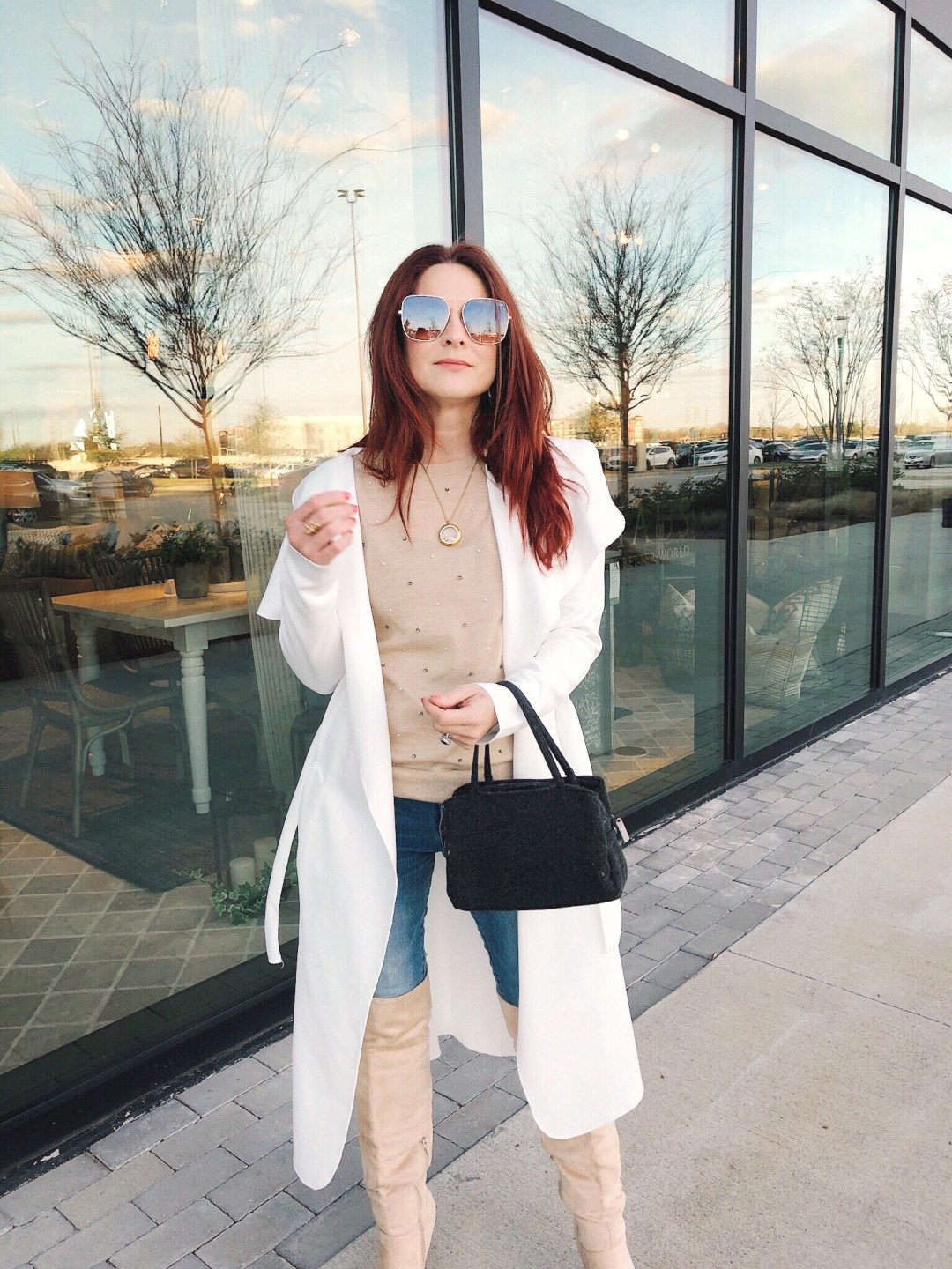 wool handbags, otk cream boots, sweaters with embellishments, suare mirror sunglasses, white duster, over the knee boot outfit ideas