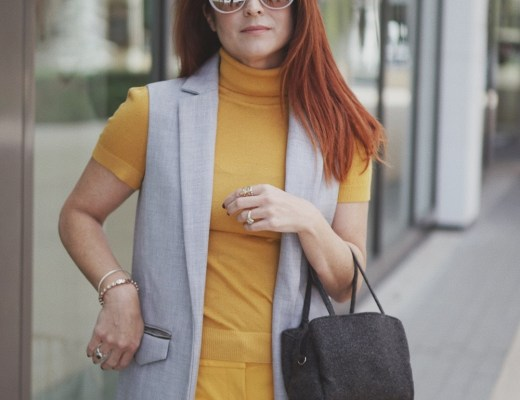 yellow and grey outfit inspiration, grey vest outerwear, dark grey bags, red hair inspiration