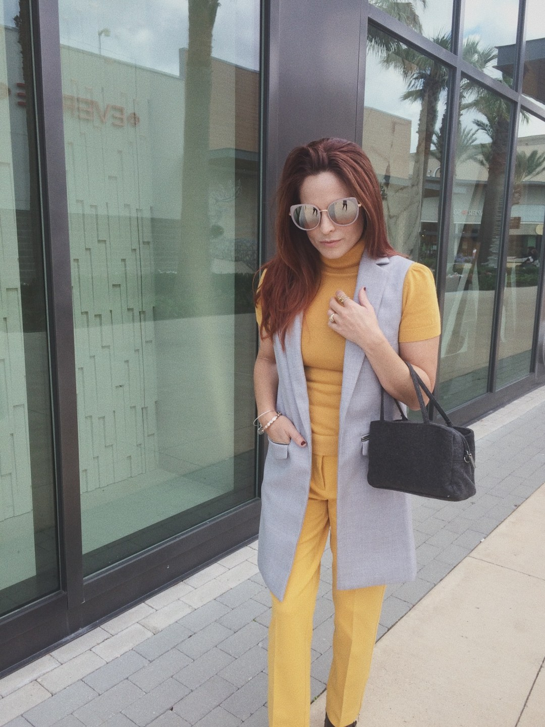 grey handbag, yellow sweater, yellow trousers, monochrome outfit ideas