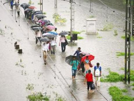 rains-halt-mumbai-commuters-hit-hard-as-local-trains-cancelled