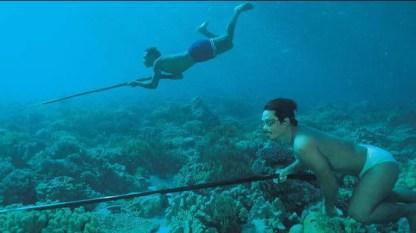 Bajau men spear fishing
