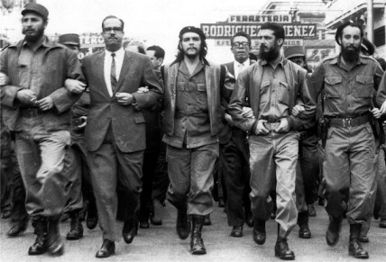 Che Guevara marching with Fidel Castro.