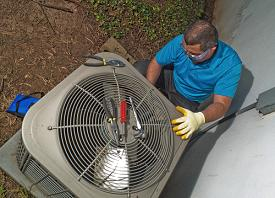 tech working on ac system
