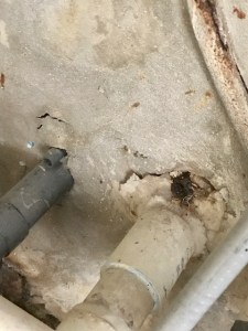 Crumbling wall around pipe