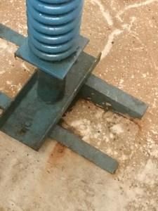 Elevator pit buffer coil