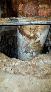 Exposed pipe with build up