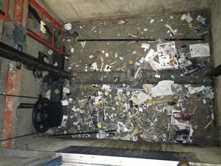 elevator pit with trash