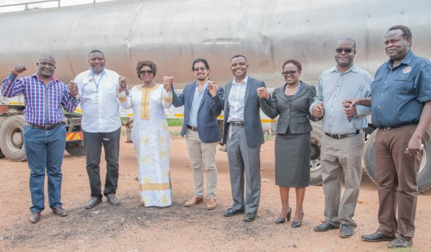 Hon. Margaret Mwanakatwe, Zambian Breweries country director Jose Moran and corporate affairs director Ezekiel Sekele with LWSC managing director Jonathan Kampata and staff as they deliver safe clean water to Bauleni.