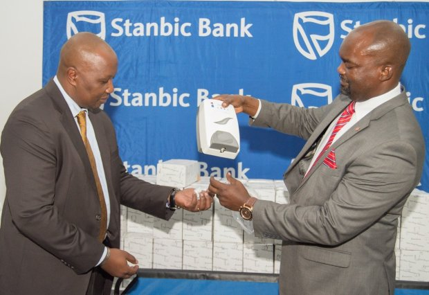 Stanbic Bank hands over hand sanitisers to Lusaka schools