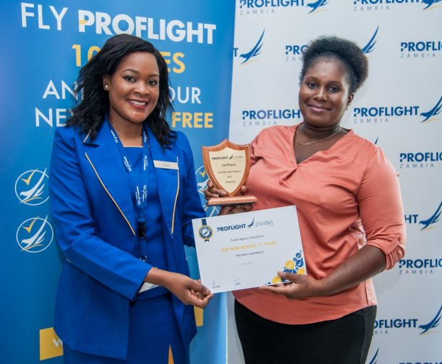 Proflight Marketing Manager Hellen Ngwira Mwamba presents the award for the Top New Agency to Ukwenda.