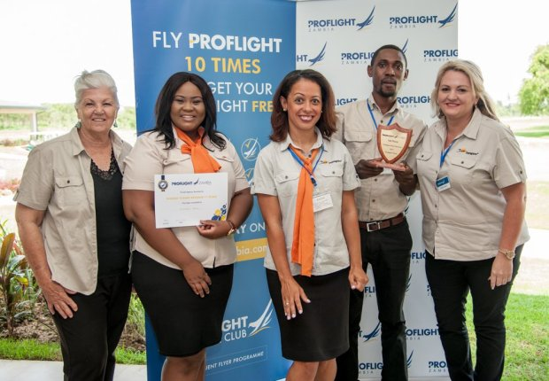 The Voyagers team with their Proflight award for the Highest Flown Revenue.
