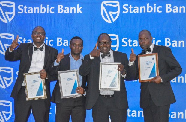 Exceptional performance: Staff from Stanbic Bank Zambia with their Mark of Excellence Awards.