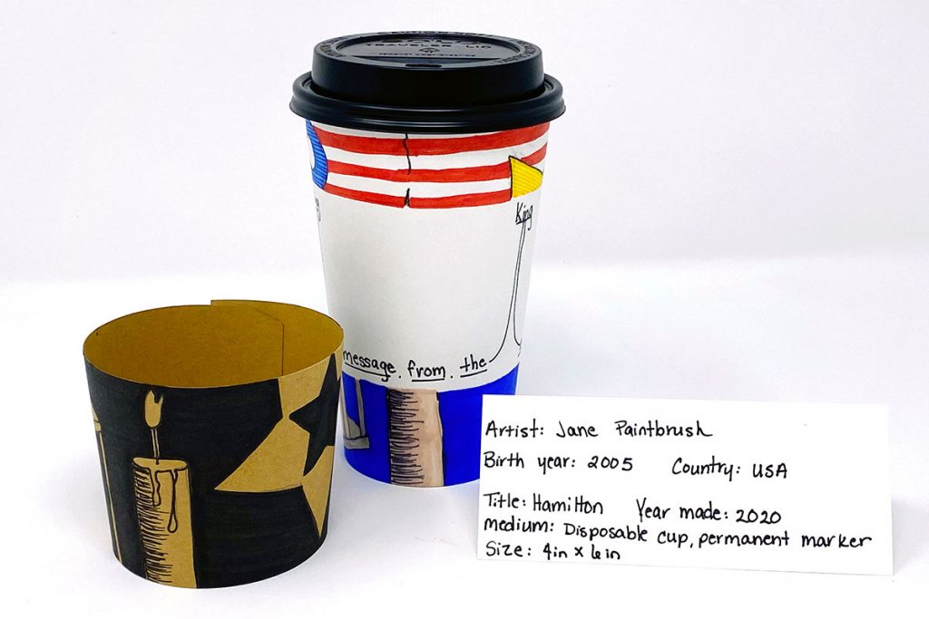 Student model using disposable coffee cup with drawings and paintings