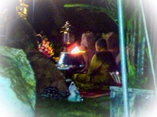 Kroo Ba Krissana Intawano blessing amulets inside a cave