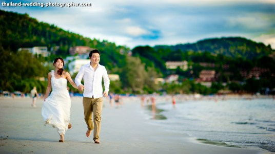 Happy Wedding Couple Running on Phuket Beach