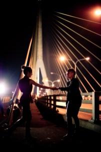 Pre-Wedding photo shoot of a lesbian couple on Rama VIII Bridge in Bangkok.